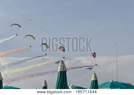 Bellaria Italy - June 05 2016: Five paramotors in parade on the beach