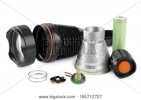 Details for assembling and repairing a LED flashlight the components of a flashlight isolated on a white background
