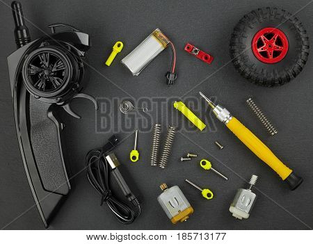 Various parts for radio-controlled models on a dark background top view