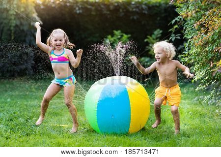 Kids Playing With Water Ball Toy Sprinkler