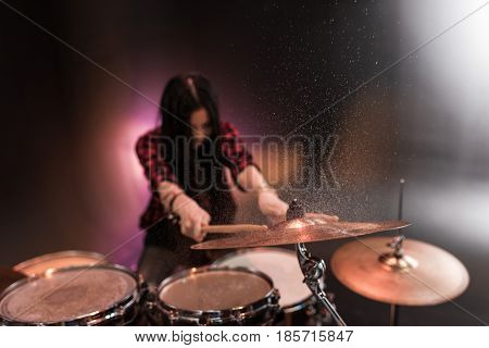 Rock And Roll Girl Playing Hard Rock Music With Drums Set