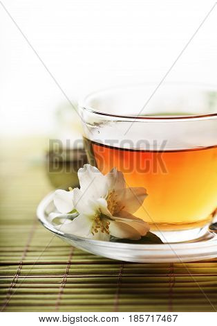 Jasmine tea cup over white background with copyspace