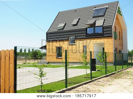 KIEV UKRAINE - MAY 15 2017:  Modern House Building with energy saving and energy efficiency. Eco-house or eco-home. Roofing Construction with attic window skylights solar panels and solar water heater (SWH) system. Passive House