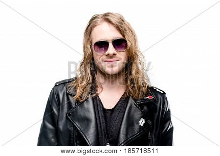 portrait of handsome rocker in black leather jacket posing isolated on white