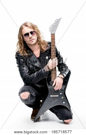 handsome rocker posing with electric guitar isolated on white electric guitar player concept