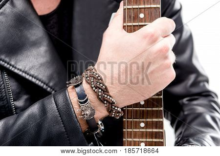 cropped view of rocker in black leather jacket posing with electric guitar isolated on white electric guitar player concept