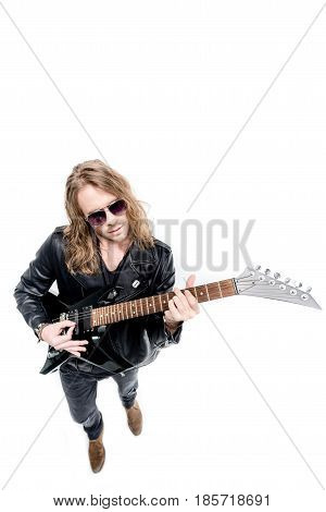 handsome rocker in sunglasses posing playing electric guitar isolated on white electric guitar player concept