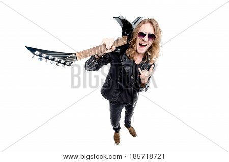 handsome rocker with electric guitar showing rock sign isolated on white rock star guitar concept