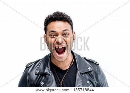 Portrait Of Emotional African American Rocker In Black Leather Jacket Isolated On White