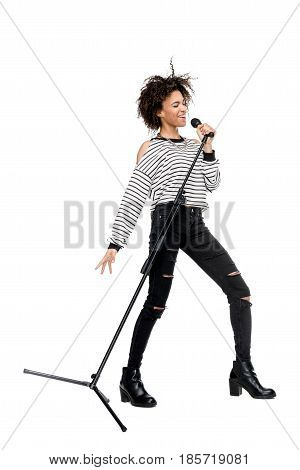 African American Young Woman Singing With Microphone Isolated On White, Female Singer With Microphon