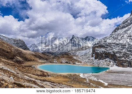 Green scared milk lake also called niunai lake at a high altitude in Yading Daocheng Si Chuan Province.