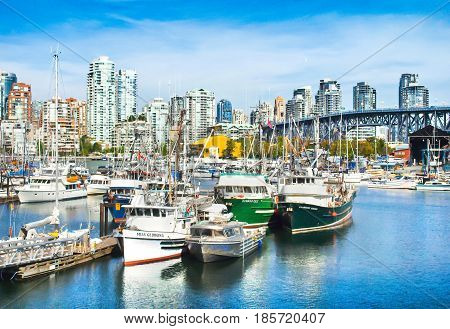 Beautiful View Of Vancouver Skyline With Granville Bridge And Ships Lying In Harbor At False Creek,
