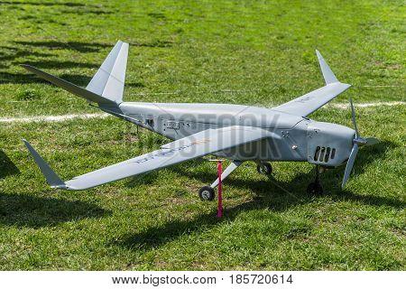 Kyiv Ukraine - April 29 2017: An unmanned aerial vehicle (UAV) Skylark of the National Aviation University on the green grass in Kyiv Ukraine.
