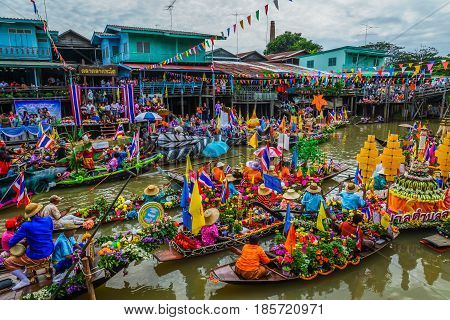 AYUTHAYA THAILAND - JULY 11, 2014: Buddhists do candle festival parade by boat at Ladchado canal in Ayuthaya Thailand.