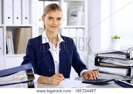 Modern business woman or confident female accountant in office.