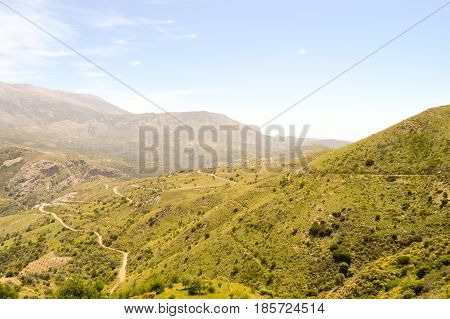 Winding road in the mountain of the center of Crete.