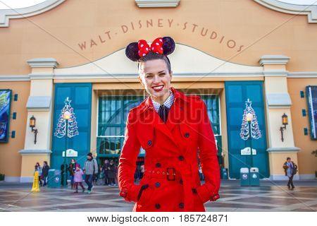 Happy Elegant Woman In Front Of Disney Studio 1