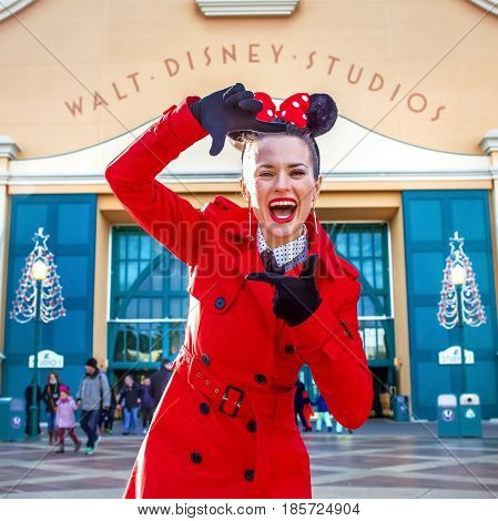 Happy Woman In Front Of Disney Studio 1 Framing With Hands