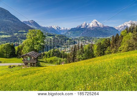 Idyllic Spring Landscape In The Alps With Traditional Mountain Lodge