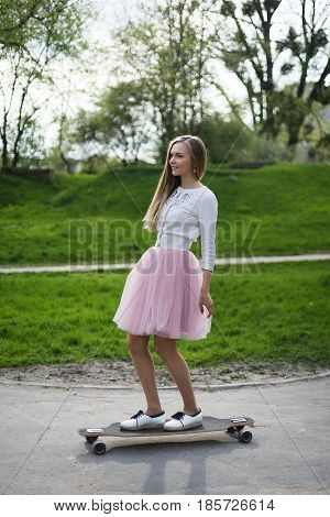 Young woman summer longboard pink skirt tutu ports skirt s