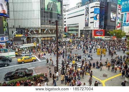 Tokyo, Japan - April 22, 2017: aerial view from Occitane Cafe of unidentified pedestrians in Shibuya Crossing, one of the busiest crosswalks in the world.