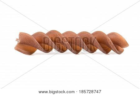 Raw brown pasta fusilli isolated on white background