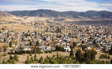 The hillside home and downtown of Butte Montana with winter setting in