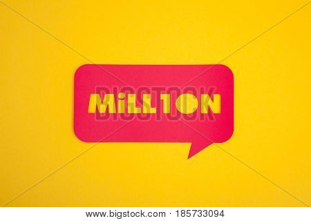 The million word cut-out in the red colored bubble on the yellow background from above.