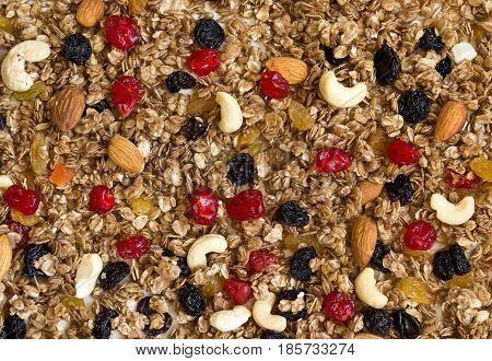 Texture Granola with dried cherries and nuts. Food background and healthy eating concept.