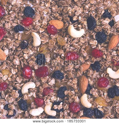 Texture Granola with dried cherries and nuts. Food background and healthy eating concept. Toned