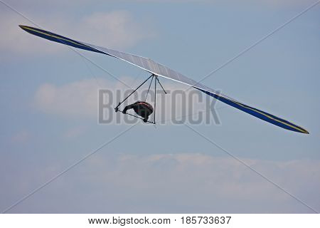 Hang glider flying in a blue sky