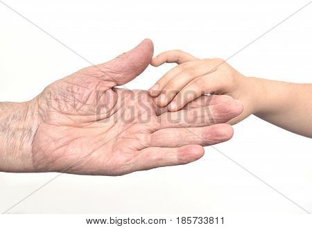 Hands of old man and child (grandfather and grandson)