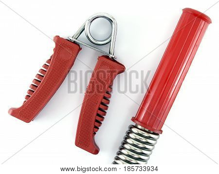 red spring grip and power twister bar on white background, equipment for exercise and bodybuilding, closeup top view