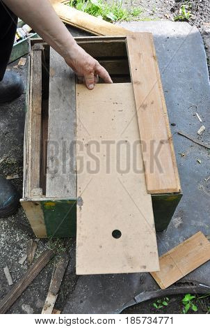 Beekeeper building wooden trap for wild bees or for swarming bees. Honey Bees Trap for Capture a Swarm and Install it in a Beehive.
