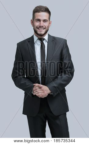 Portrait of a smiling business man standing in profile. Isolated