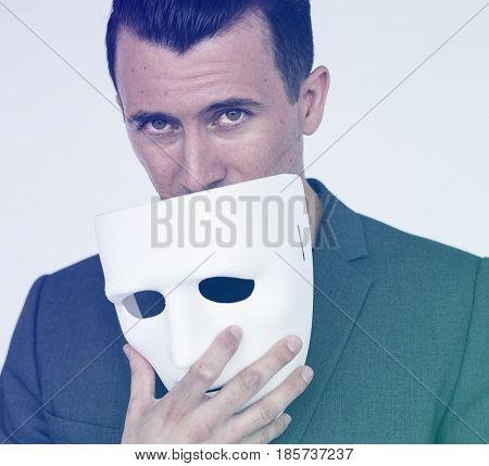 Man Hand Hold Mask Studio Portrait