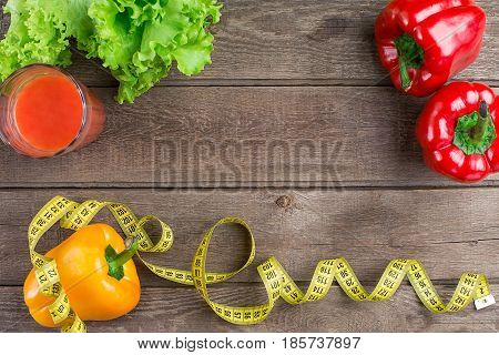 Fitness concept with vegetables. Fitness motivation with centimeter. Fitness motive. Pepper. Colorful pepper. Vegetable with centimeter. Healthy food and diet. Copy space
