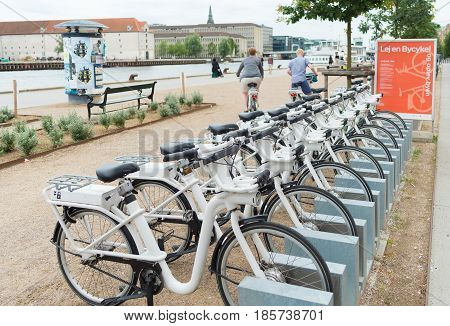 COPENHAGEN DENMARK - JULY 31 2016: Row of white rental Go-bikes which can be hired per hour