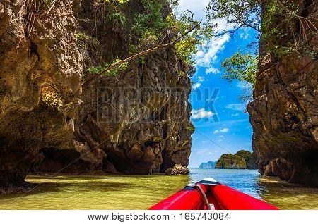 Large cliff limestone rock in Phang nga bay for kayaking paddling pass through and explore Thailand