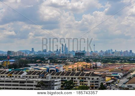 Aerial view of the skyline of Kuala Lumpur from the Batu Caves in Malaysia