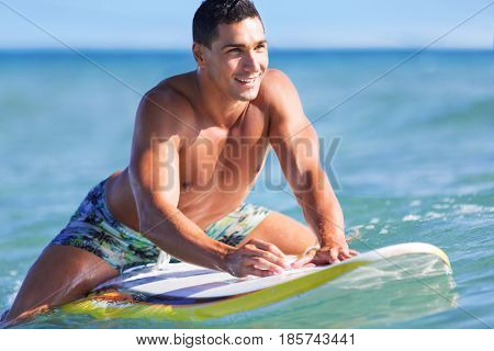 Stand up paddle board man paddleboarding on Hawaii standing happy on paddleboard on blue water. Young caucasian male model on Hawaiian beach on summer holidays vacation travel