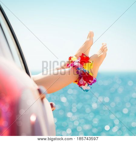Woman legs against emerald sea background. Summer vacations concept