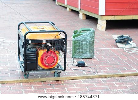 Standby Generator - Outdoor Power Equipment. Mobile Backup Generator on the construction site. Diesel Generator.