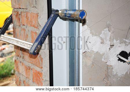 Close up on Installing Garage Door with Metal Holder.