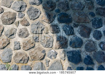 Stones. Closeup of a massive Stone Wall. Big Stone Walls. Light and Shadow on a Stone Wall