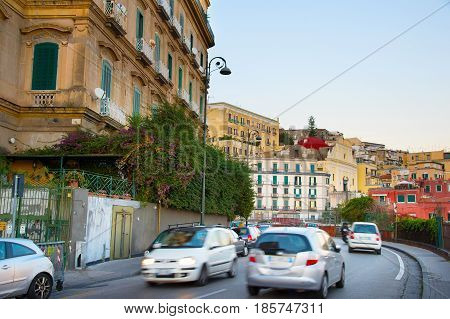 Speedy traffic on a Naples street at twilight. Italy