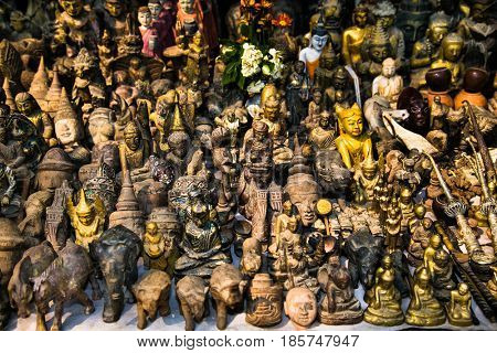Wooden budha statues and figurines on street shop in Mingun, Myanmar. (Burma)