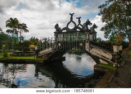 An Artificial Bridge With Four Statues Of Dragons With Twisted Tails, Tirta Gangga Park, Karangasem,