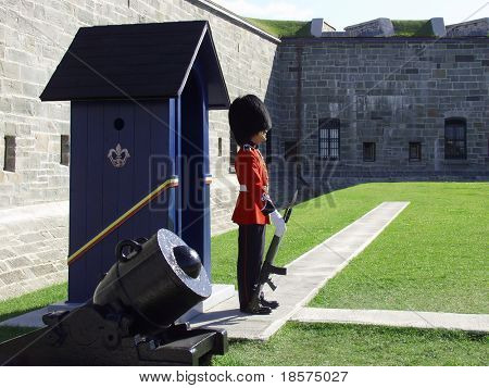 A member of the Canadian Royal 22nd Regiment stands guard at the gates to the Citadel in Old Quebec City, Quebec, Canada.