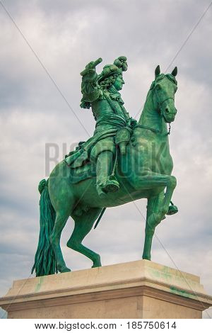 Horse and rider statue in a park in paris